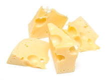 Cheese on white. Some slices of cheese on white. The isolated image on white. Shallow DOF Royalty Free Stock Photos
