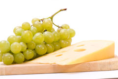 Cheese and white grapes Stock Images