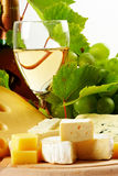 Cheese and wine. Various types of cheese , fruits and wine Royalty Free Stock Photography