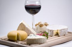 Cheese and wine. On cutting board stock image