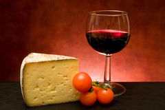 Cheese And Wine. Food And Drinks - Still life with cheese and red wine Royalty Free Stock Photo