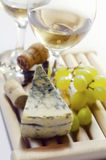 Cheese and wine. Various sorts of cheese, grapes and two glasses of the white wine Royalty Free Stock Images