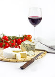 Cheese and wine. Fresh cheese, tomatoes and wine Stock Image