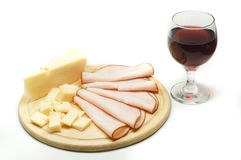 Cheese and wine. Cheese, smoked turkey sliced and a glass of wine in white background Stock Image