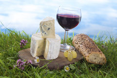 Cheese, wine and and bread, French culibary Scene Royalty Free Stock Photo
