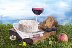 Cheese, wine and and bread, French culinary Scene Royalty Free Stock Photo