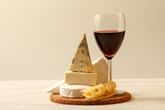 Cheese and wine. Composition with wine,various types of  cheese  on wooden table Stock Image