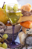 Cheese, wine and fruits Stock Photos