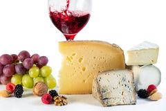Cheese and wine with fruits and nuts. Royalty Free Stock Images