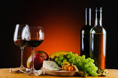 Cheese, wine and fruits royalty free stock photography
