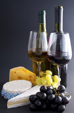Cheese, wine, grapes stock photography