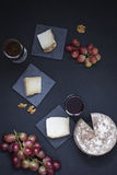 Cheese, wine and grapes Stock Photo