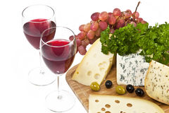 Cheese, wine, grapes, olives and parsley Royalty Free Stock Images