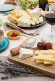 Cheese and wine. High angle view of dinner table with cheese and wine Royalty Free Stock Photos