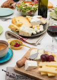 Cheese and wine. High angle view of dinner table with cheese and wine Royalty Free Stock Photo