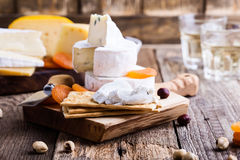 Cheese and wine party  table, goat cheese with  crackers Royalty Free Stock Photo