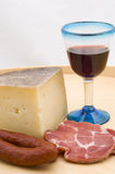 Cheese and wine on white Stock Image