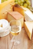 Cheese and wine on a wooden table Stock Photos