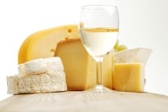 Cheese and wine on a wooden table Stock Image