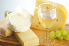 Cheese and wine on a wooden table Royalty Free Stock Photography