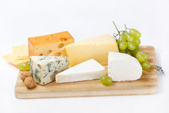 Cheese on wood board royalty free stock images