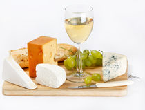Cheese on wood board Stock Images