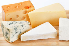 Cheese on wood board Royalty Free Stock Image