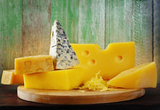 Cheese on wood Royalty Free Stock Images