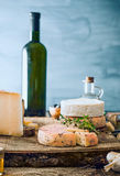 Cheese on wood Stock Images
