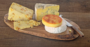 Cheese on wood Stock Photos