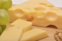 A cheese on wooden board. The cheese on wooden board Royalty Free Stock Image
