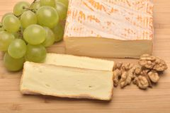 A  cheese on wooden board. The cheese on wooden board Stock Photo
