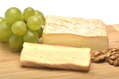 A cheese on wooden board. The cheese on wooden board Royalty Free Stock Photo