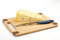 Cheese on a wooden board Stock Images