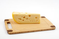 Cheese on a wooden board Stock Image