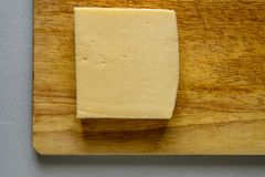 Cheese on a wooden board stock photos
