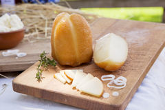 Cheese on wooden board. Royalty Free Stock Images