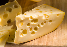 Cheese on wooden board Royalty Free Stock Photography