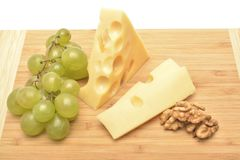 A cheese on wooden board. The cheese on wooden board Stock Images