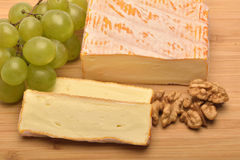 The   cheese on wooden board. A  cheese on wooden board Stock Photos
