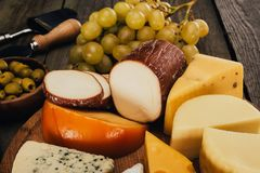Cheese on wooden board Royalty Free Stock Images