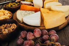 Cheese on wooden board Stock Images