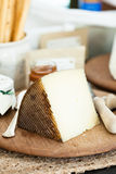 Cheese on wooden board Royalty Free Stock Image