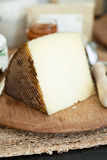 Cheese on wooden board Stock Image
