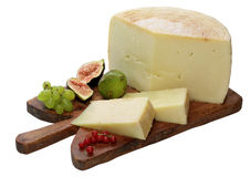 Cheese on wooden board Royalty Free Stock Photos