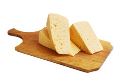 Cheese on a wooden board Royalty Free Stock Image