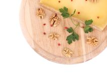 Cheese on a wooden board. Royalty Free Stock Images