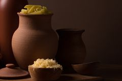 Cheese in a wooden bowl Royalty Free Stock Photography