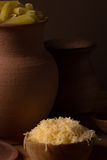 Cheese in a wooden bowl Stock Photography