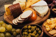 Cheese on wooden cutting board Royalty Free Stock Image